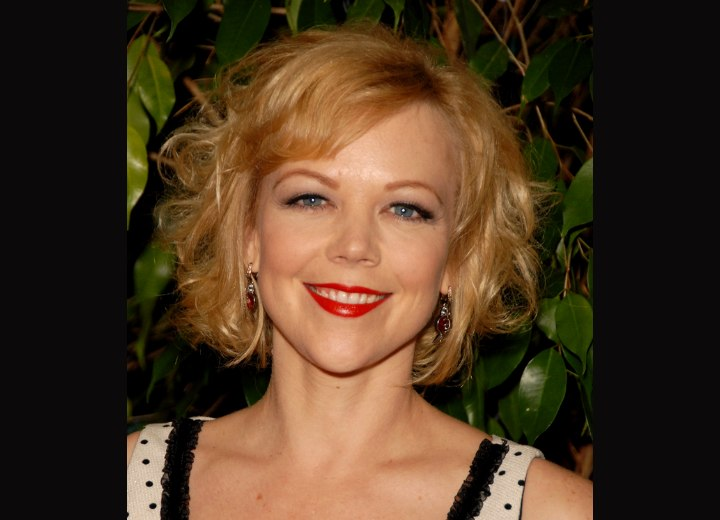Emily Bergl - Midway upon the neck hairstyle with curls