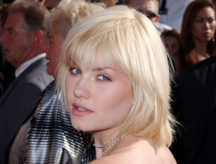 Side view of Elisha Cuthbert's neck long tapered hairstyle