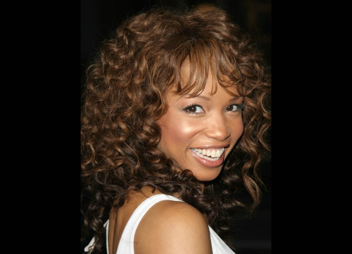 Elise Neal with her long hair styled into spiral curls