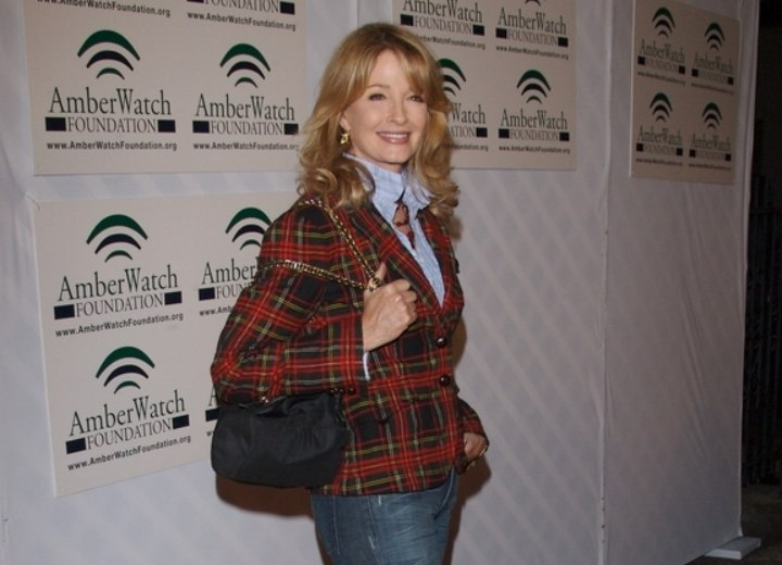 Deidre Hall wearing a blouse with the collar turned up