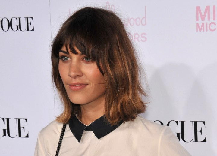 Alexa Chung wearing a fashionable collared blouse