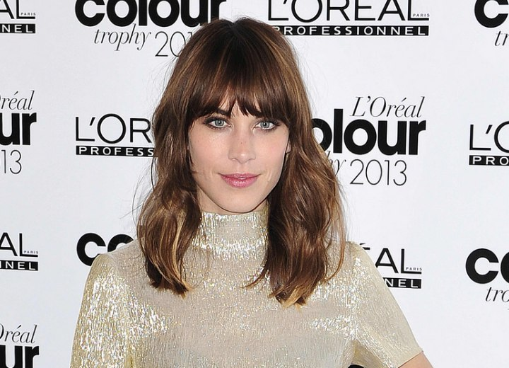 Alexa Chung with bangs that fall right at the eye