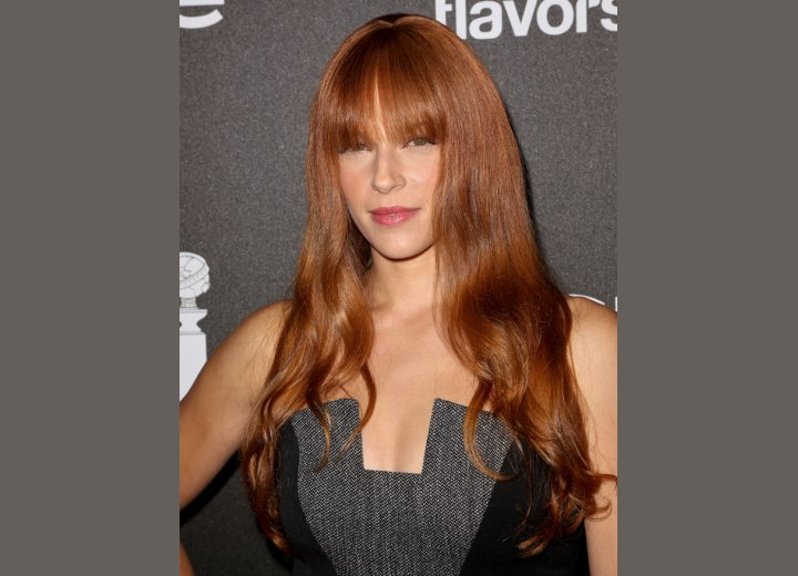 Amanda Righetti with long hair and long blunt bangs