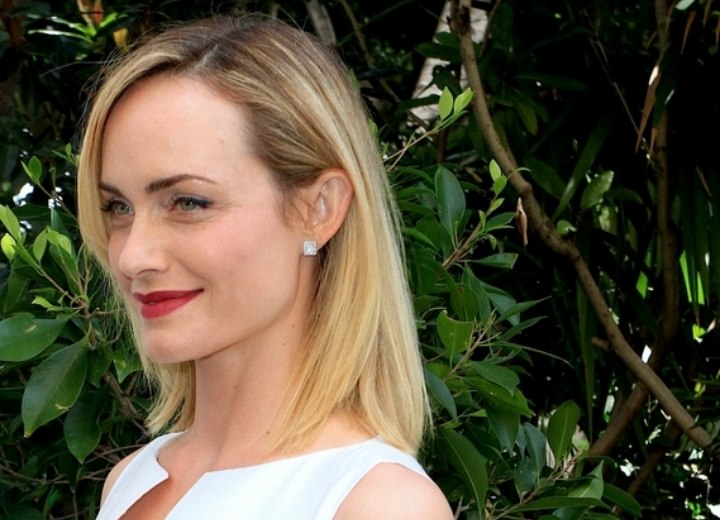 Side view of Amber Valletta's simple sleek hairstyle