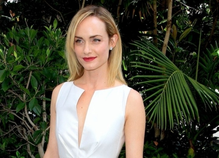 Amber Valletta wearing a white dress for a luncheon