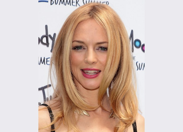 Heather Graham's blonde hair with warm tones