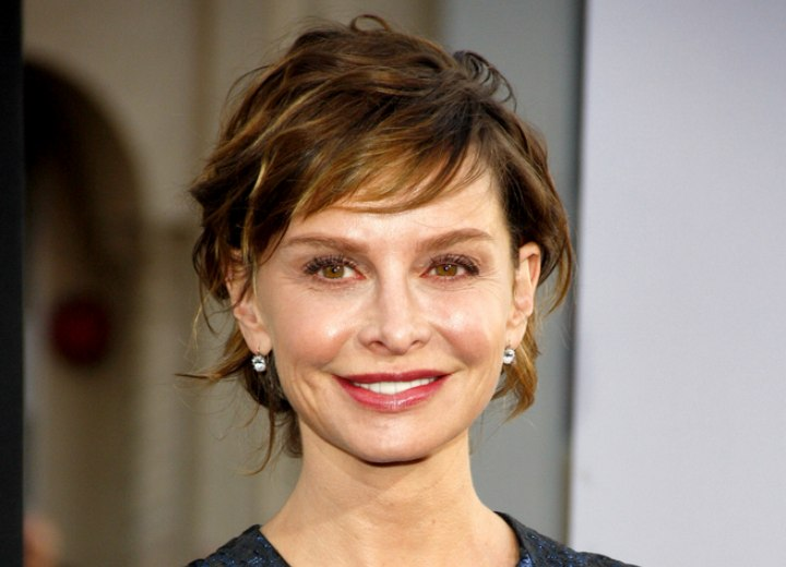 Calista Flockhart with her hair swept back in an updo
