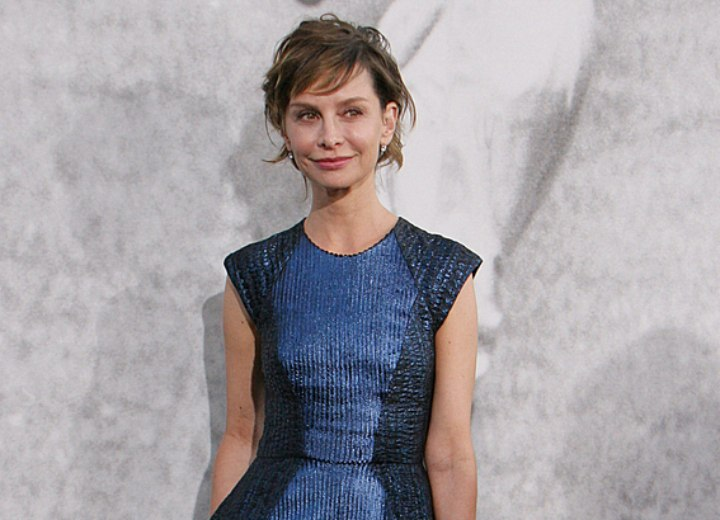 Calista Flockhart wearing a shiny blue knee length dress