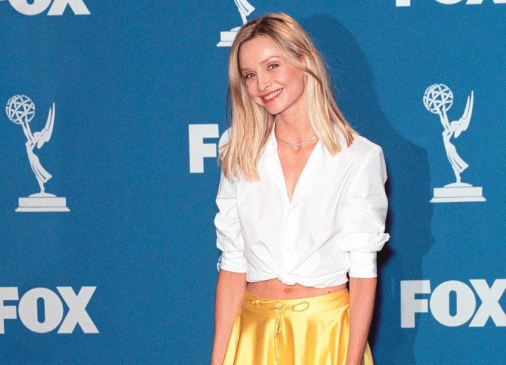 Calista Flockhart wearing a blouse and showing her midriff