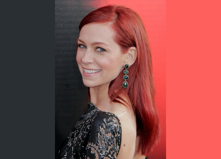 Carrie Preston with long and deep red hair