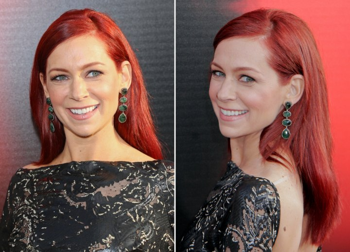 Carrie Preston's hairstyle with her hair tucked behind her ears