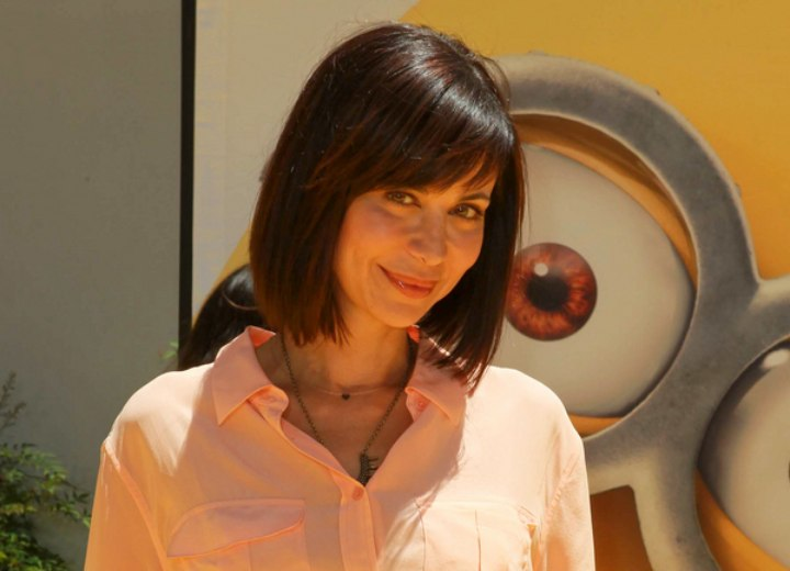 Catherine Bell wearing a bob hairstyle that is longer in front