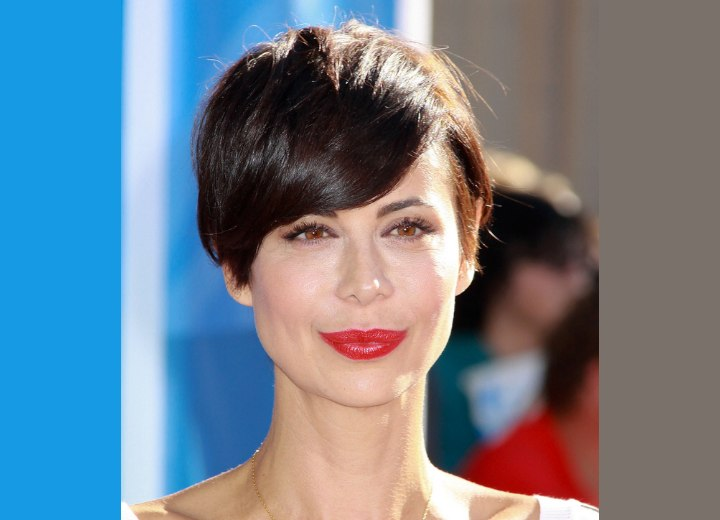 Catherine Bell's short pixie hairstyle with side bangs