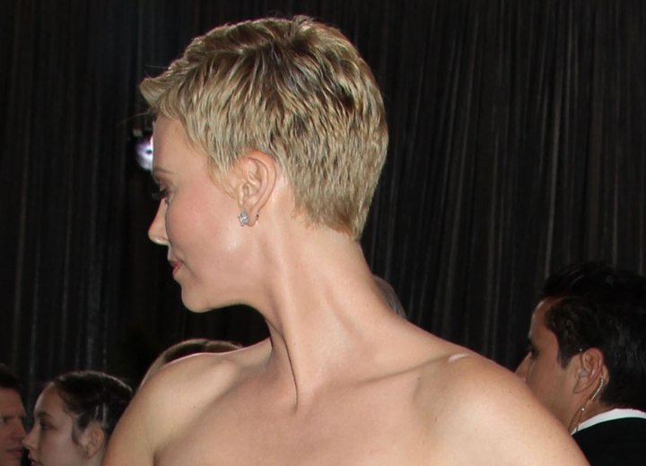 Side view of Charlize Theron's short pixie cut