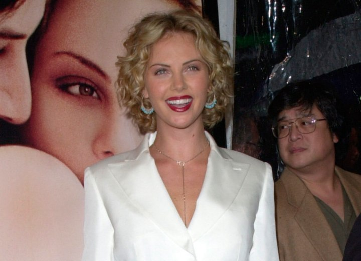 Charlize Theron wearing a white suit