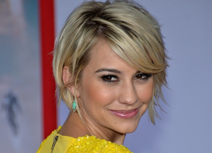 Short flirty hairstyle with bangs - Chelsea Kane