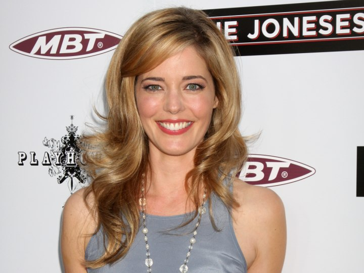 Blonde hair that suits the eye color and skin tone - Christina Moore