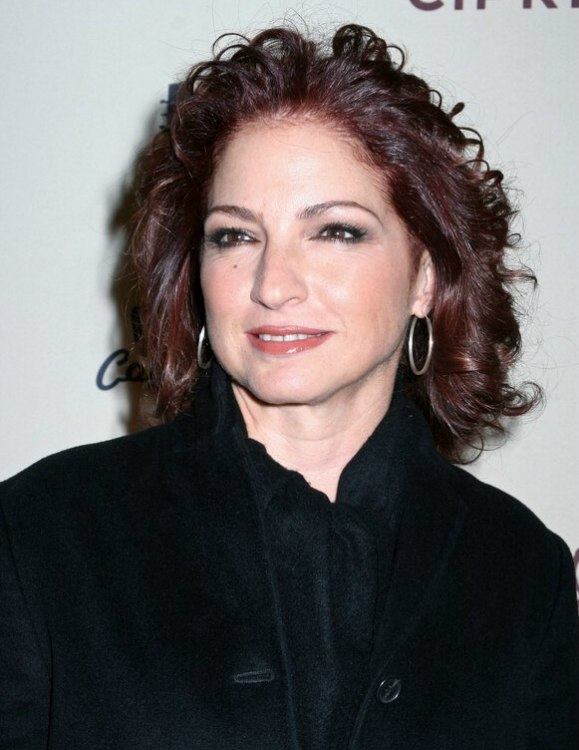 Gloria Estefan | Shoulder long hairstyle with curls and red highlights