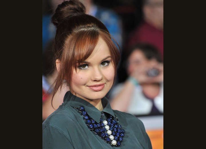Debby Ryan - Top knot hairstyle with loose bangs