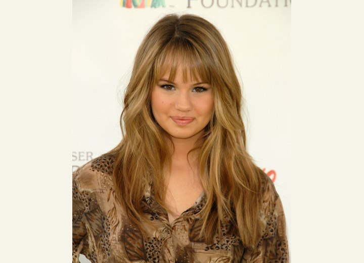 Debby Ryan - Past the shoulders hairstyle with layers