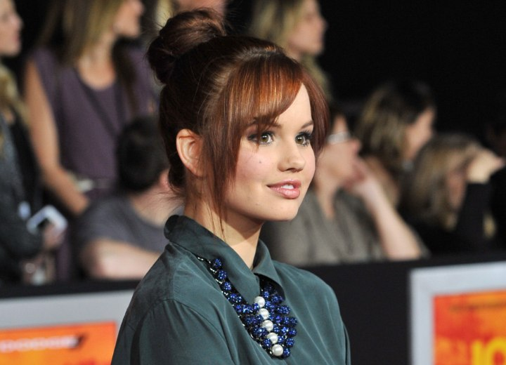 Debby Ryan wearing her hair up and away from her collar