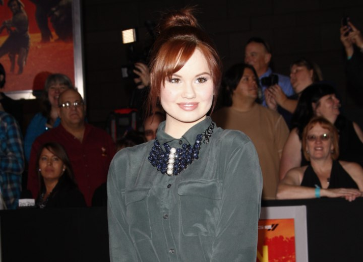 Debby Ryan wearing a silk shirt with buttoned-up collar