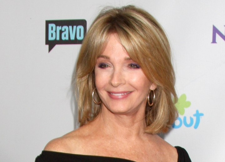 Deidre Hall - Hairstyle with split bangs to camouflage wrinkles