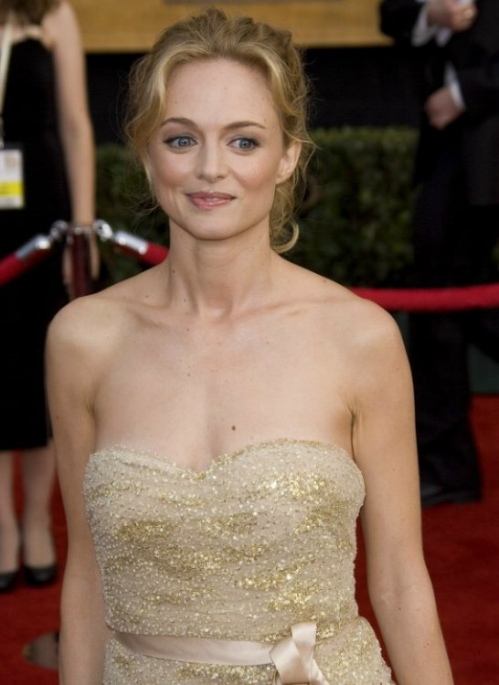 heather graham wearing hair styled up with cascading curls