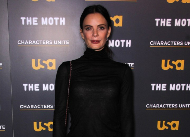 Gabrielle Anwar wearing a black scrunch turtleneck