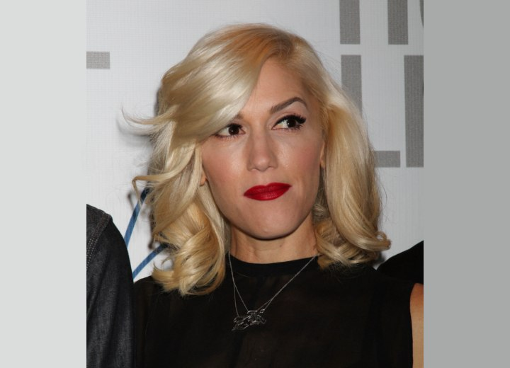 Gwen Stefani wearing her hair with coils around her shoulders