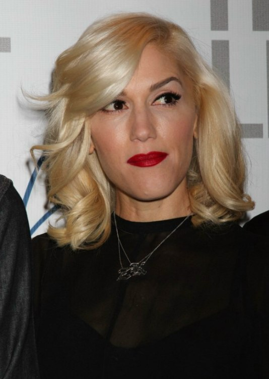 Gwen Stefani Long Hairstyle With A Dip Over One Eye And A High