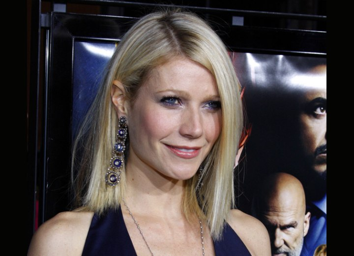 Gwyneth Paltrow with her hair styled behind one ear