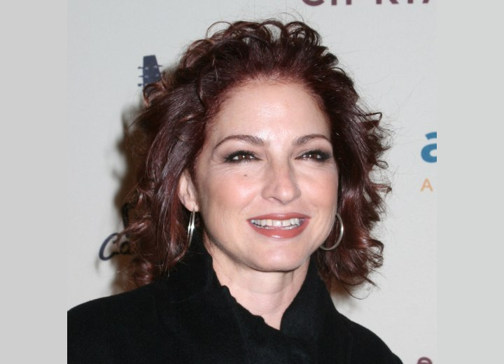 Gloria Estefan - Hair color with depth and red highlights