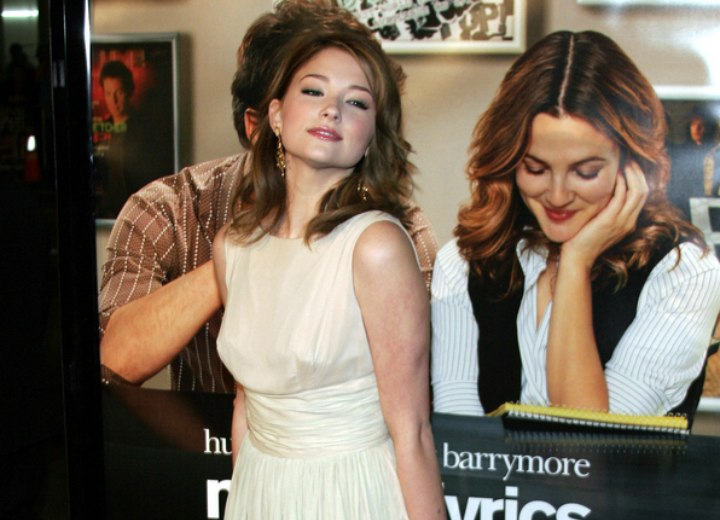 Haley Bennett wearing a dress in a color that suits her red hair tint