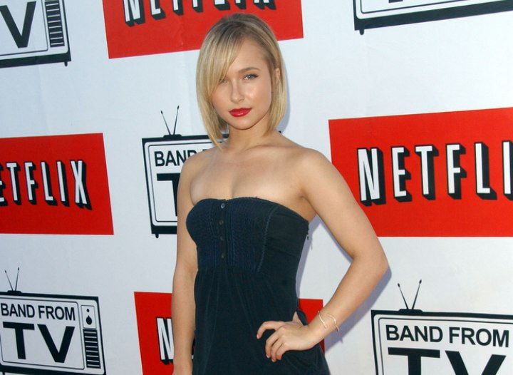Hayden Panettiere wearing a very short buttoned black dress