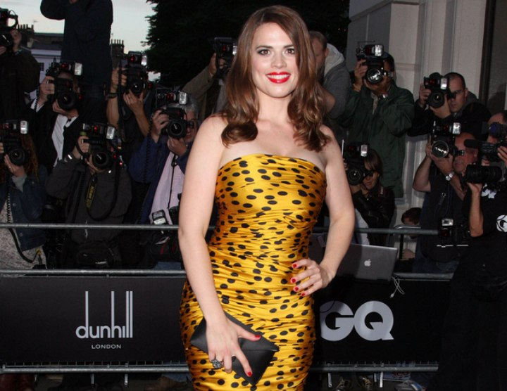 Hayley Atwell wearing a gold and black polka dot dress