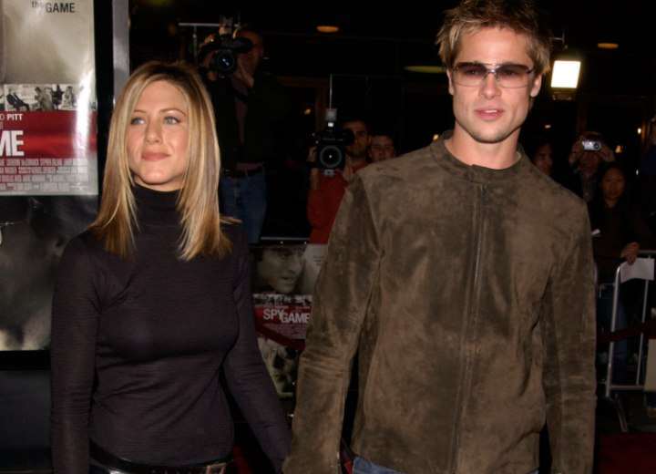 Jennifer Aniston wearing a turtleneck and leather skirt