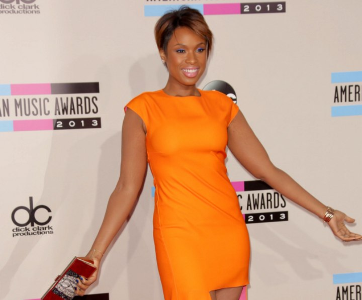 Jennifer Hudson look with a pixie and orange dress