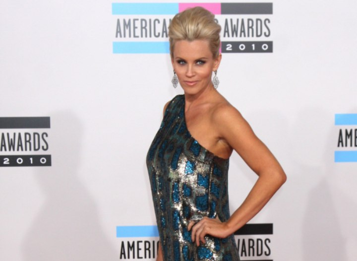 Jenny McCarthy wearing a one-shouldered mini dress