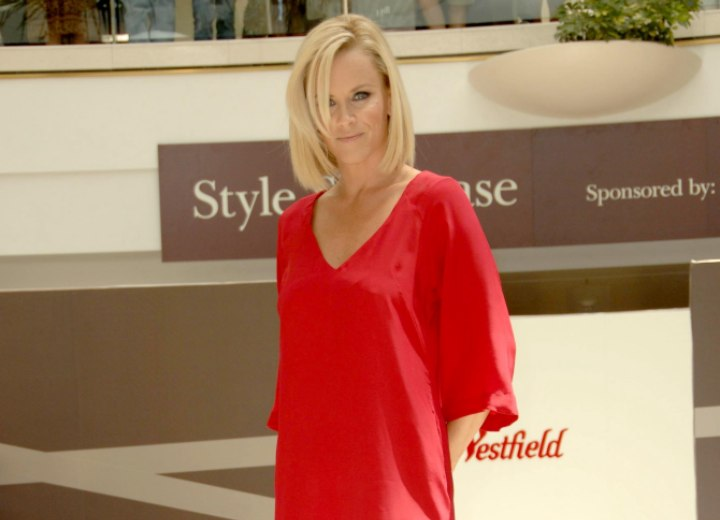 Jenny McCarthy wearing a red V-neck dress