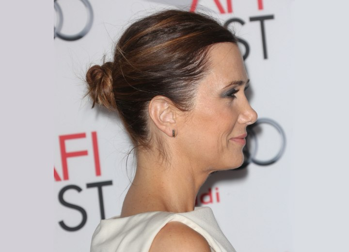 Kristen Wiig with her hair pulled into a ballerina knot