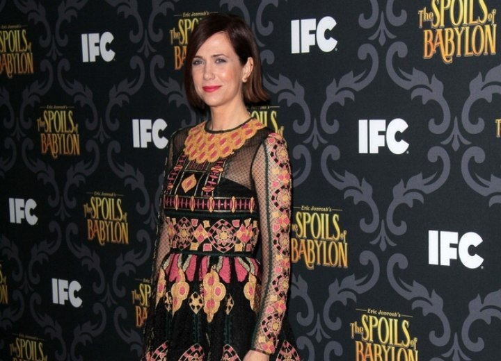 Kristen Wiig look with short hair and a colorful dress