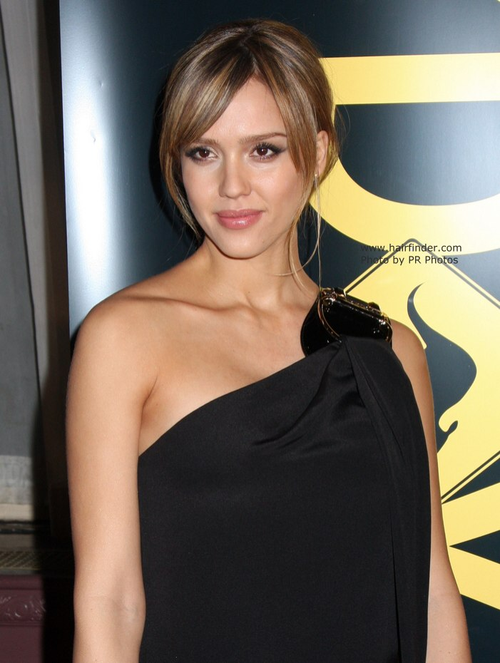 Jessica Alba Hairstyle With A Long Fringe And A Nape Area Knot