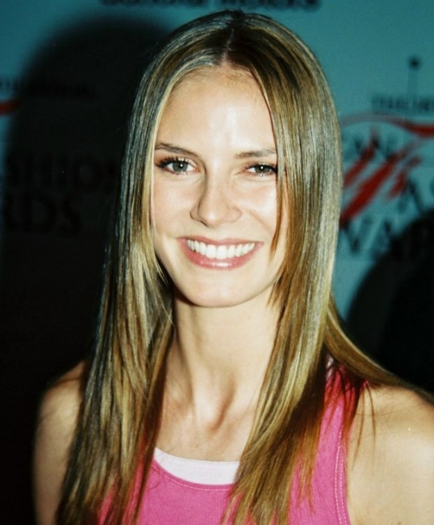 Heidi klum wearing her long hair sleek with chopped ends heidi klum long sleek hairstyle ith a middle part urmus Images