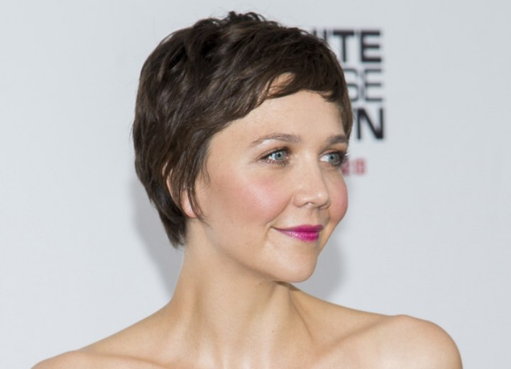 Maggie Gyllenhaal with a super short pixie haircut