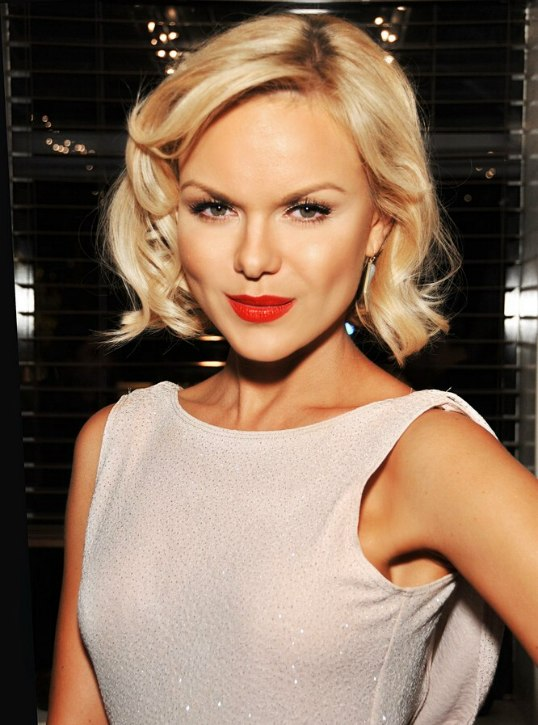 Anya Monzikova Classic Short Bob Haircut With Blonde Curls For A