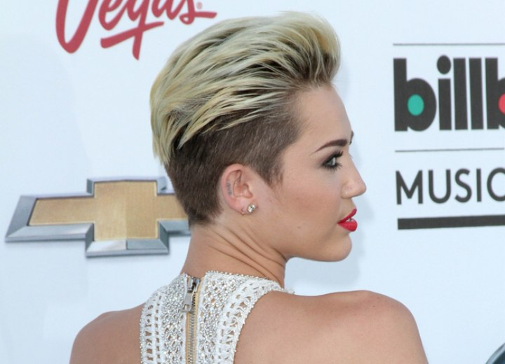 Miley Cyrus with her hair buzzed close to the scalp