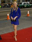 Nancy O'Dell look with a short blue dress and hoop earrings