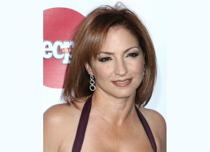 Gloria Estefan - Brown hair color for an olive skin