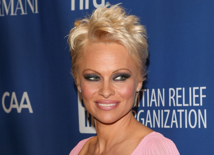 Pamela Anderson with her hair cut in a pixie